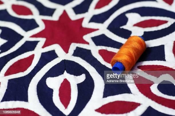 Spool of Thread on Appliqué Textile
