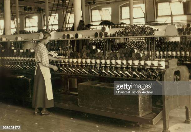 Spooler Tender 15 years old Berkshire Cotton Mills Adams Massachusetts USA Lewis Hine for National Child Labor Committee July 1916
