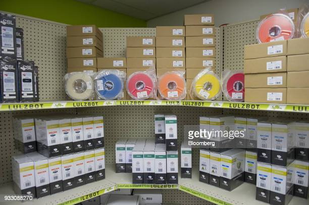 Spools of 3D printing filament sit on a shelve at the Aleph Objects Inc LulzBot 3D printers production facility in Loveland Colorado US on Wednesday...