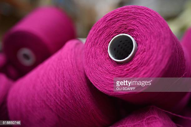 Spools of assorted coloured thread are stored before being woven at Abraham Moon and Sons woollen mill in Guiseley, northern England on March 30,...