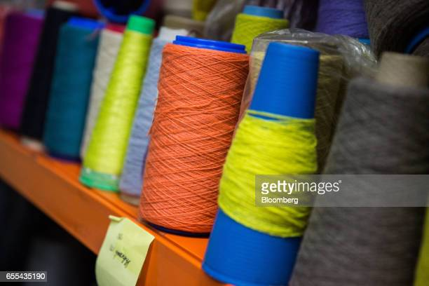Spools of cashmere thread sit on a shelf at a Bodios Co garment factory in Ulaanbaatar Mongolia on Wednesday March 15 2017 Mongolia's gross domestic...