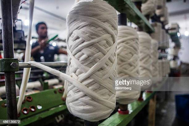 Spools of dehaired pashmina is processed into threads at the spinning unit of the Valley Wool Ltd factory in Srinagar Jammu and Kashmir India on...