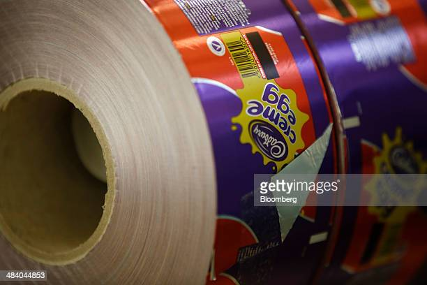 Spools of foil used for wrapping Cadbury Creme Eggs sit ready for use in the Bournville Cadbury factory operated by Mondelez International Inc in...