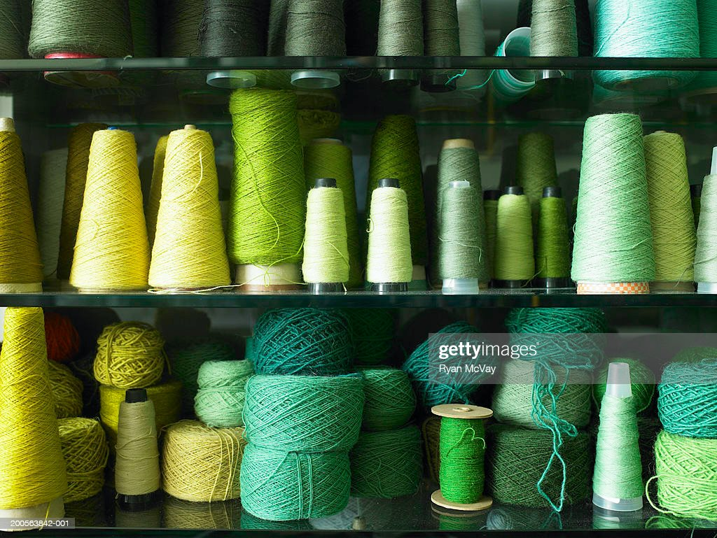 Spools of thread and balls of wool, close-up : Stock Photo