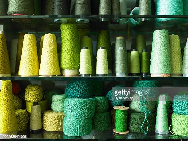Spools of thread and balls of wool, close-up
