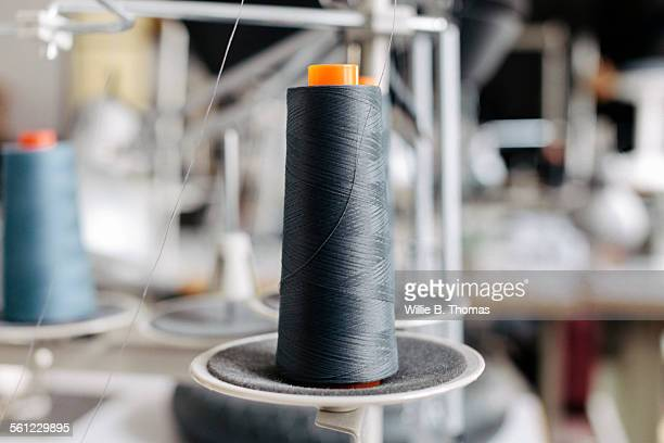 Spools of thread on sewing machine