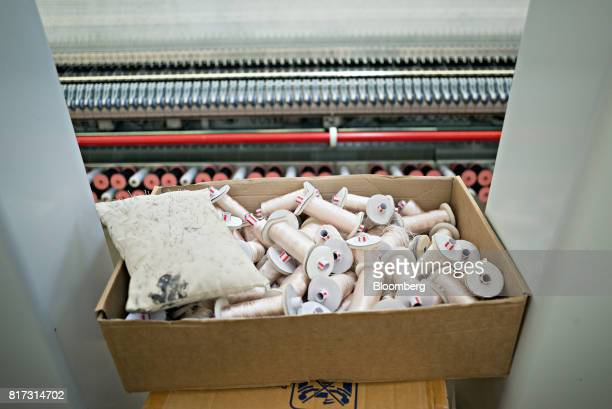 Spools of thread sit in a box in the stitching hall at the Forster Rohner AG textile production workshop in St Gallen Switzerland on Wednesday May 31...