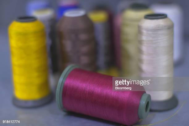 Spools of thread sit in the stitching unit at the Artistic Denim Mills Ltd factory in Karachi Pakistan on Tuesday Feb 6 2018 Pakistans manufacturers...