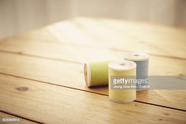 Spools On Wooden Table