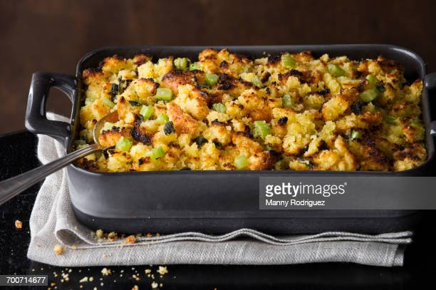Spoon in tray of stuffing