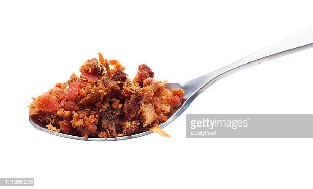 spoon of bacon bits - part of stock pictures, royalty-free photos & images