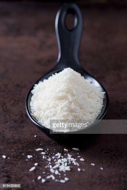 Spoon of coconut flakes