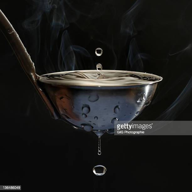 Spoon of hot boiling water