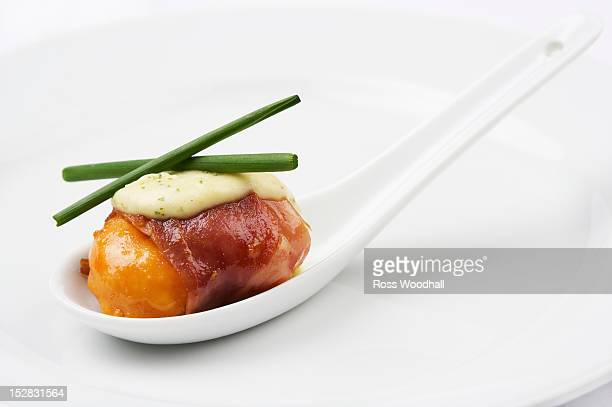 Spoon of scallop with pancetta