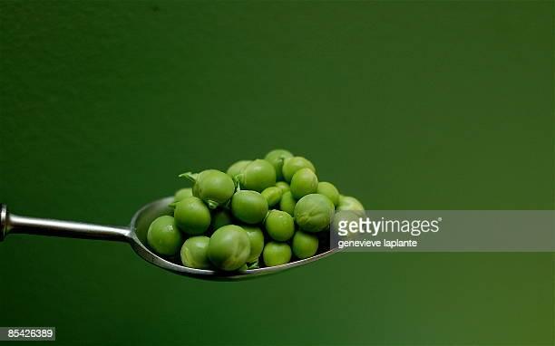 Spoon on green peas