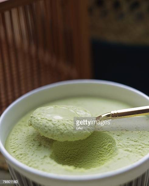 Spoon scooping green tea ice cream, high angle view, differential focus
