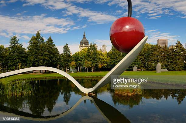 Spoonbridge and Cherry over a pond in Minneapolis Sculpture Garden with Saint Mary Basilica