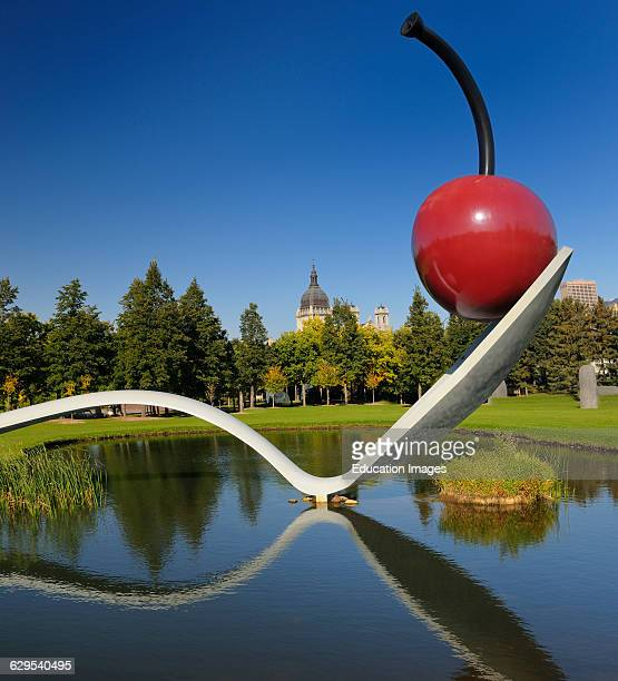 Spoonbridge and Cherry over water in Minneapolis Sculpture Garden with Saint Mary Basilica