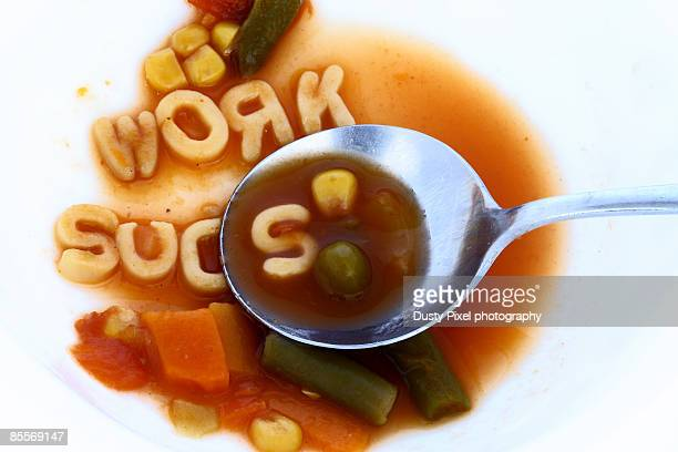 spoonful of alphabet soup bowl - capital letter stock pictures, royalty-free photos & images