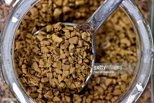 Spoonful of coffee granules in jar