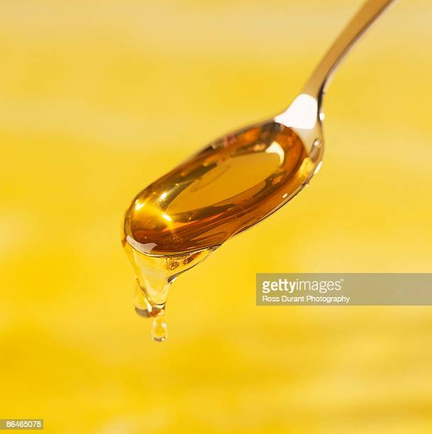 spoonful of honey - honey ross stock pictures, royalty-free photos & images