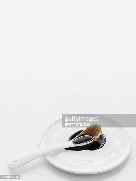 spoonful of oyster sauce on plate - soy sauce stock pictures, royalty-free photos & images