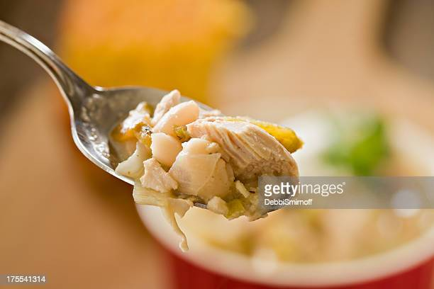 spoonful of white chicken chili - chili stock photos and pictures