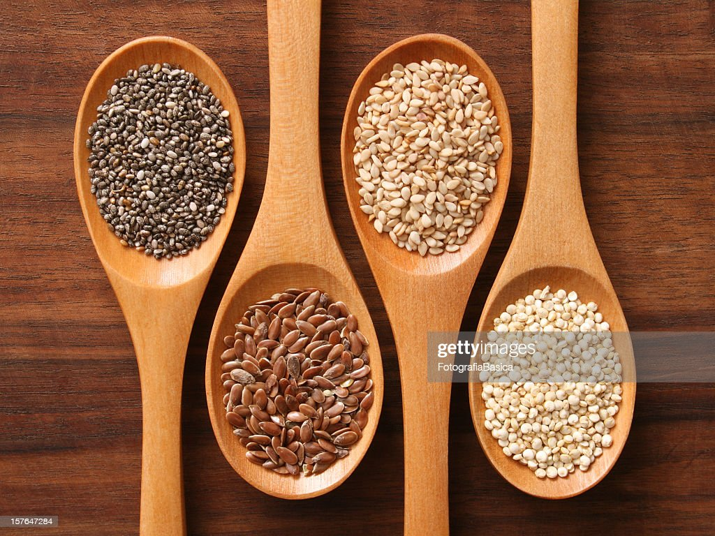 Spoons and healthy seeds : Stock Photo