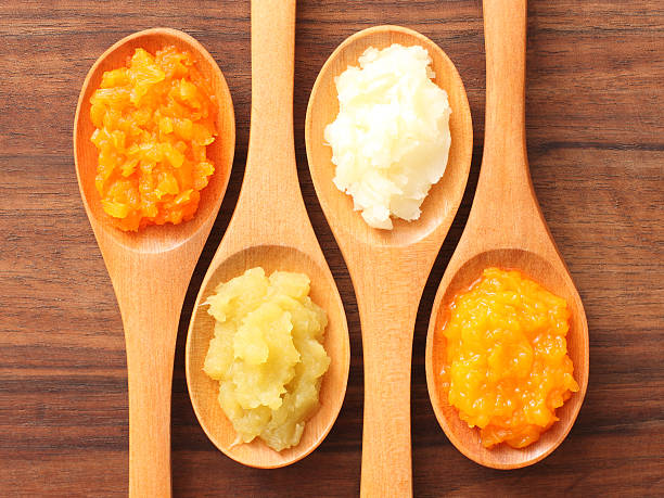 spoons and purees - potato puree stock pictures, royalty-free photos & images