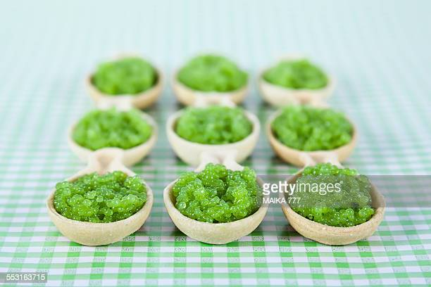 spoons of bread with seaweed green caviar & wasabi - wasabi sauce stock pictures, royalty-free photos & images