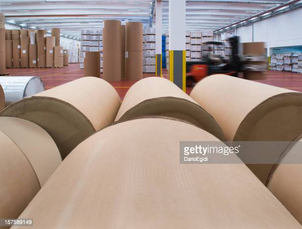 Spoons of paper in warehouse of printing company