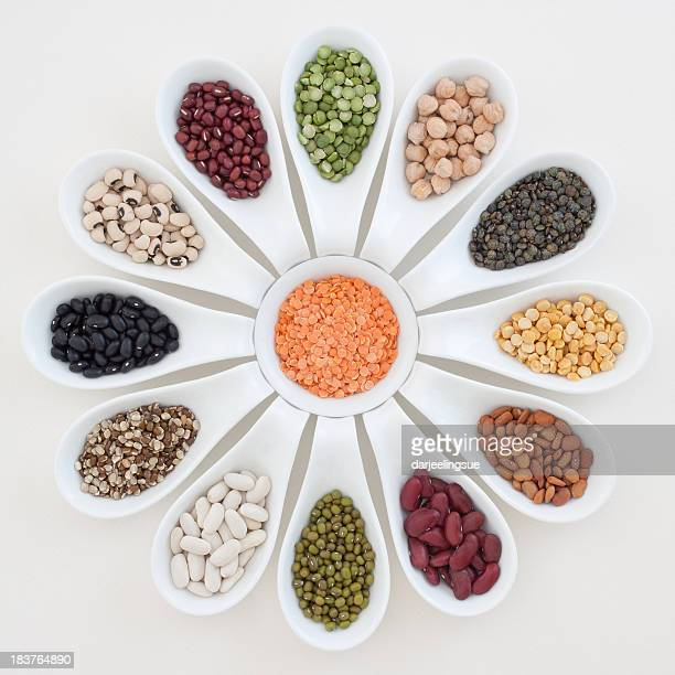 Spoons with beans, lentils and peas