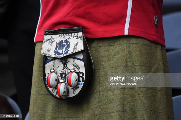 Sporran with mini rugby balls is worn by a fan before a rugby union match between British and Irish Lions and Japan at Murrayfield stadium in...