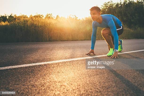 Sporsman preparing to run.