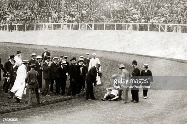 Sport, 1908 Olympic Games in London, Athletics, pic: 24th July 1908, Mens Marathon, Italy's Pietri Dorando falls for the third time in the stadium...