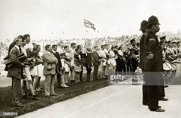 Sport 1908 Olympic Games in London Athletics pic 25th July 1908 Athletes in a line up at the medal ceremony amongst them Mens Marathon winner John...
