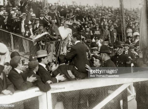 Sport 1908 Olympic Games in London Athletics pic 25th July 1908 Mens Marathon Italy's Pietri Dorando is chaired by the crowd as he carries the...