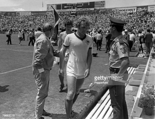 Sport 1970 World Cup QuarterFinal Leon Mexico 14th June 1970 England's captain Bobby Moore walks dejectedly off the pitch followed by manager Sir Alf...