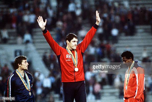 Sport 1980 Olympic Games Moscow USSR Athletics Mens 100 Metres Final Gold medal winner Alan Wells of Great Britain raises his arms on the podium as...