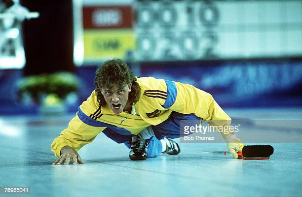 Sport 1988 Winter Olympic Games Calgary Canada Curling A competitor gets down close to the ice