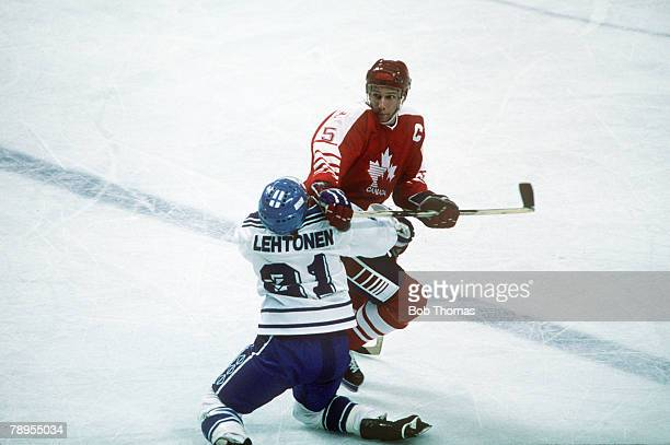 Sport 1988 Winter Olympic Games Calgary Canada pic 18th February 1988 Ice Hockey Canada 1 v Finland 3 Canada's Trent Yawney clashes with Finland's...