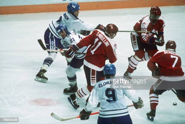 Sport 1988 Winter Olympic Games Calgary Canada pic 18th February 1988 Ice Hockey Canada 1 v Finland 3 Rival players battle for possession of the puck