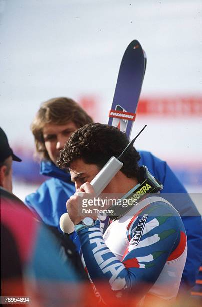 Sport 1988 Winter Olympic Games Calgary Canada Skiing Mens Giant Slalom Italy's Alberto Tomba celebrates his Gold medal success as he phones home...