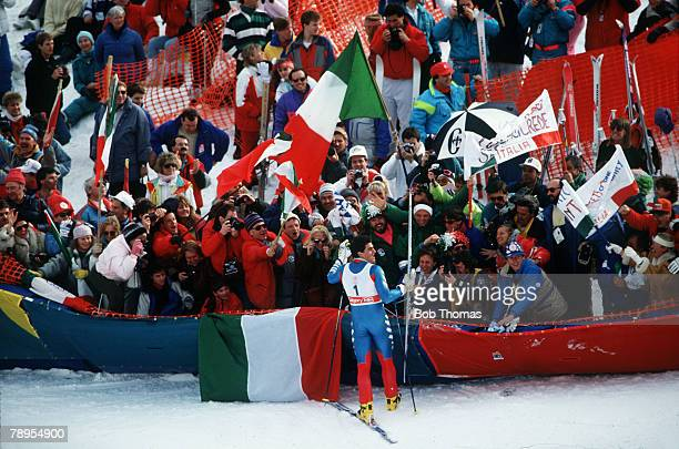 Sport 1988 Winter Olympic Games Calgary Canada Skiing Mens Giant Slalom Italy's Alberto Tomba celebrates his Gold medal success as he greets his...