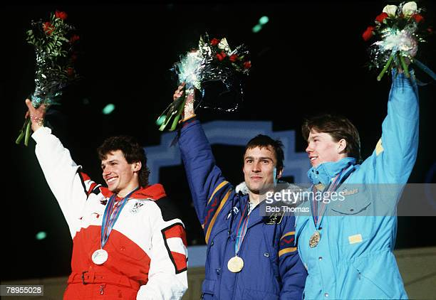 Sport 1988 Winter Olympic Games Calgary Canada Skiing Mens Super Giant Slalom The medal ceremony leftright Helmut Mayer Austria Franck Piccard France...