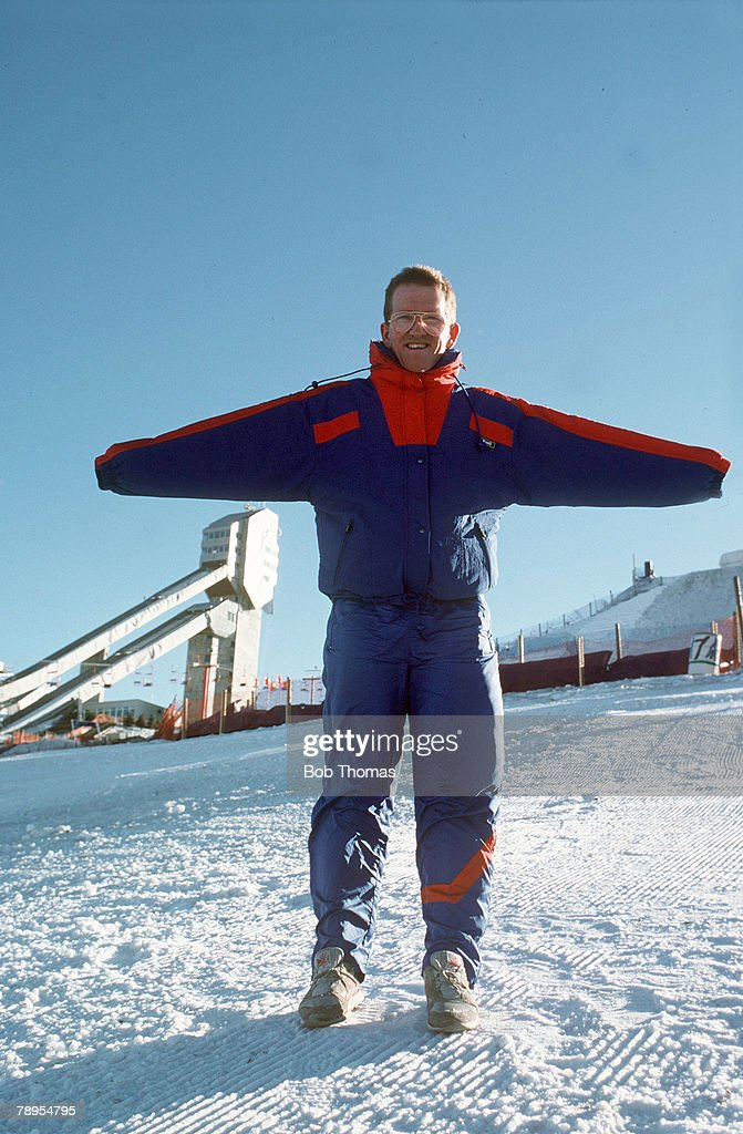 Sport, 1988 Winter Olympic Games, Calgary, Canada,Mens 70 and 90 metre Ski Jump, Great Britain's Eddie 'The Eagle' Edwards interviewed on the lift by BBC's Mike Ingham, Eddie Edwards a popular comic figure, was hopelessly outclassed and came last in his events
