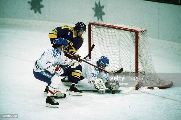 Sport 1992 Winter Olympic Games Albertville France Ice Hockey Sweden v Italy Italy goalminder Michael Zanier tries his best to block a Swedish attack