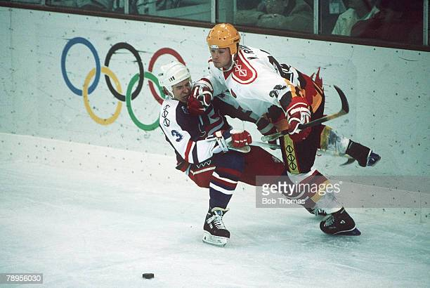 Sport 1992 Winter Olympic Games Albertville France Ice Hockey USA 2 v Germany 0 Germany's Michael Rumrich right with USA's grounded Dave Tretowicz