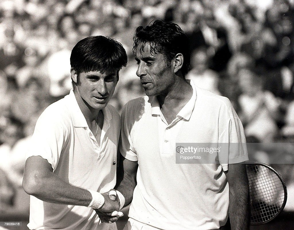 Sport, All England Lawn Tennis Championships, Wimbledon, London, England, June 1969, American's Charlie Pasarell (left) and Pancho Gonzales shake hands after their epic marathon match which Gonzales won in 5 sets, The match lasted a record 5hrs 12 mins and had 112 games, Gonzales was 41 years old at the time