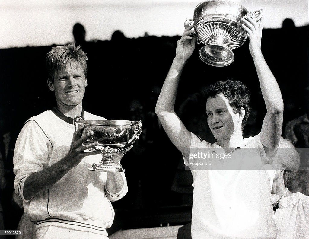 Sport, All England Lawn Tennis Championships, Wimbledon, London, England, 7th July 1984, Mens Doubles Final, The Champions Peter Fleming and John McEnroe (right) USA are pictured with the trophies